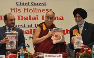 Mr Ajay S Shriram, The Dalai Lama  & Mr Analjit Singh at the SRCC Annual Day holding the In-House magazine  Yamuna (1)